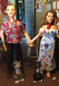 Hernandz points to the detail involved in creating the four wedding pinata, the couple and their two dogs.